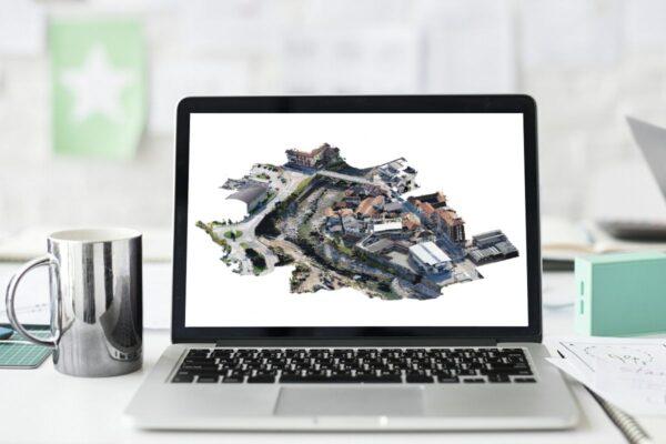 PC con Nuvola 3D di fiume ponte ed edifici